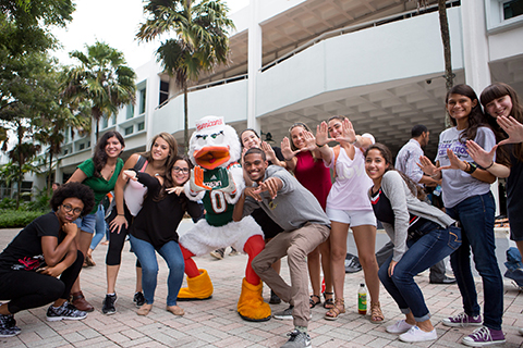 A group of students standing with Sebastian the Ibis